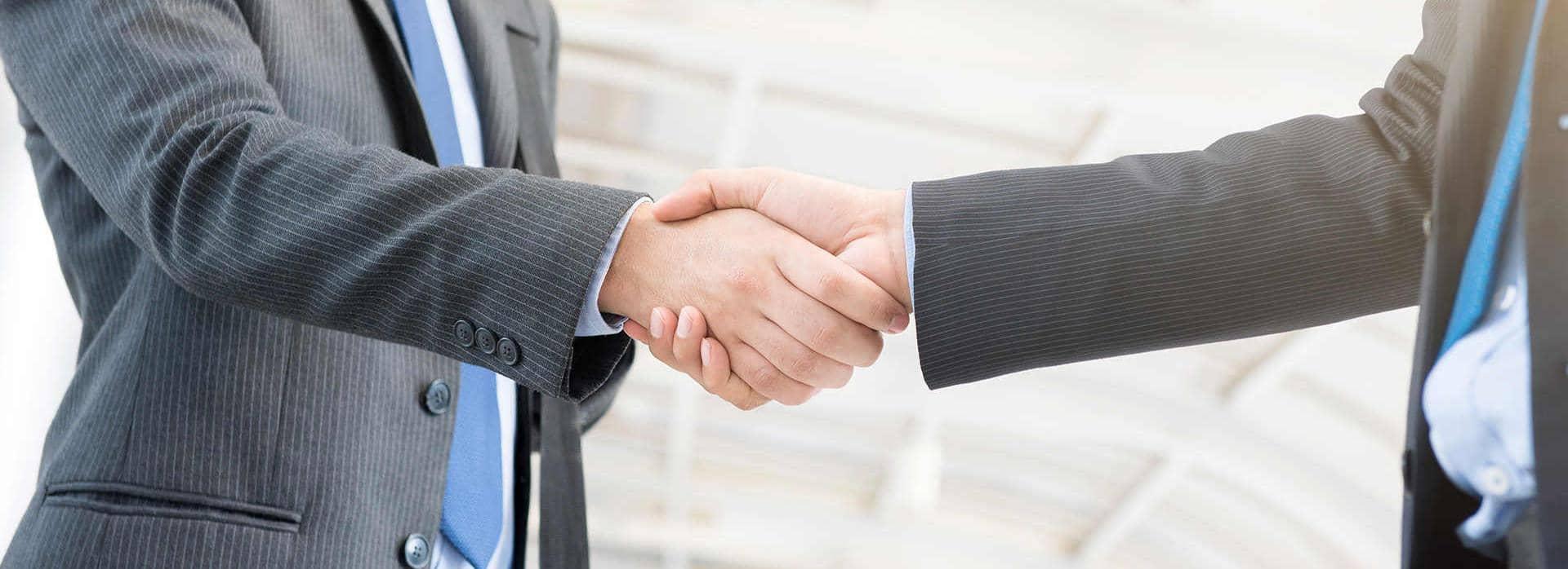 Businessmen shaking hands compliance